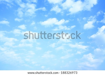 Blue sky and lots small clouds, may be used as background - stock photo