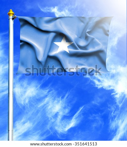 Blue sky and mast with hanged waving flag of Somalia - stock photo
