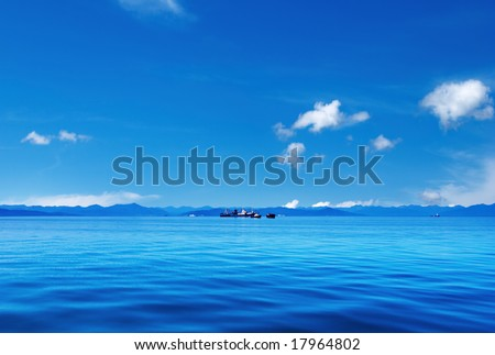 Blue sky and ocean - stock photo