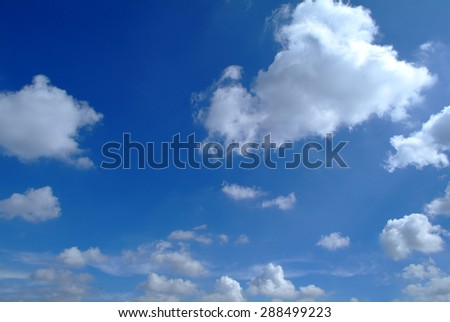 Blue Sky and puffy clouds - stock photo