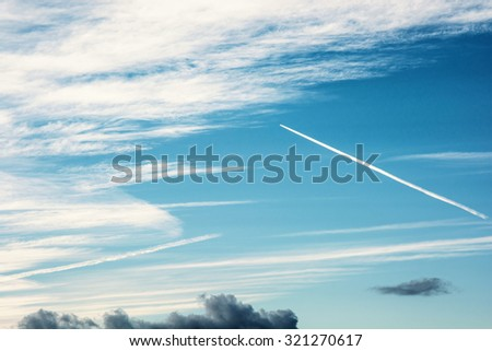 Blue sky and trace of airplane. Air transport. - stock photo