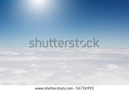 Blue sky and white clouds viewed above - stock photo
