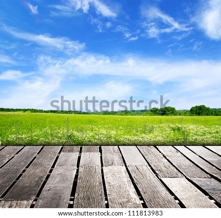 blue sky and wood floor background - stock photo