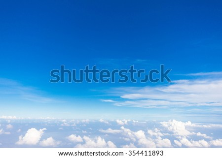 blue sky background over clouds - stock photo