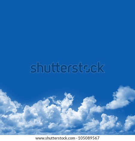 Blue Sky Background With Clouds and Space for Text Isolated on Blue - stock photo