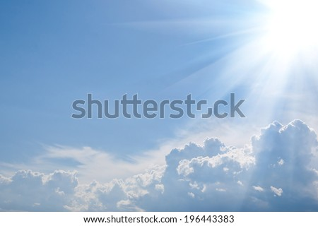 blue sky background with sunshine, dense clouds and copy-space - stock photo