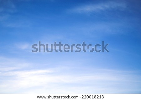 Blue sky background with tiny clouds. - stock photo
