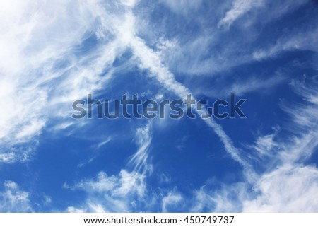 blue sky background with white clouds of different shapes - stock photo