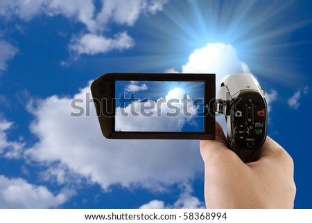 blue sky background with white clouds recording by camcorder - stock photo