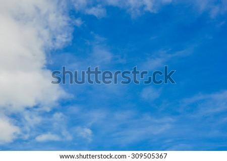 Blue sky,Blue sky background with tiny clouds, Empty sky surface - stock photo