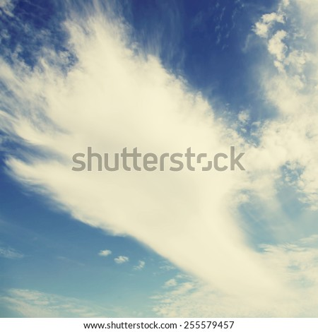 Blue sky, clouds and sun light background.Special toned photo in vintage style - stock photo