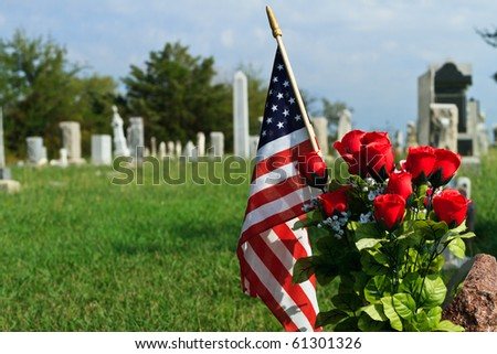 Blue sky, green grass, American Flag and graveyard - stock photo