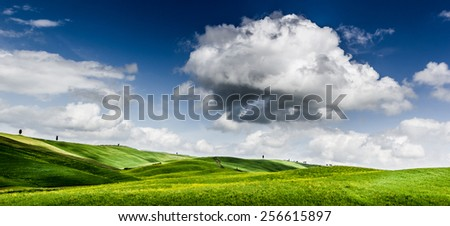 Blue Sky, green landscape, hills and panoramic view of Tuscany - stock photo