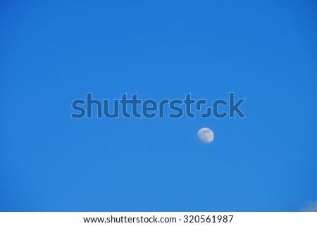 blue sky moon. - stock photo