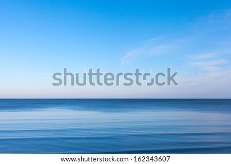 Blue sky over blue Baltic sea. - stock photo