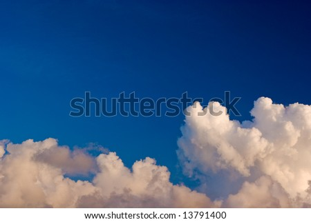 Blue Sky Over Layer of Puffy White Clouds - stock photo
