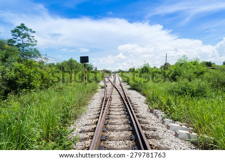 blue sky over old railroad - stock photo