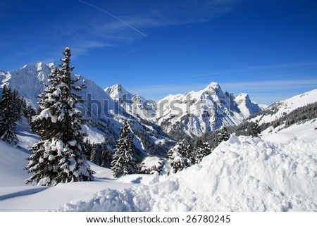 Blue sky over snowy white mountains - stock photo