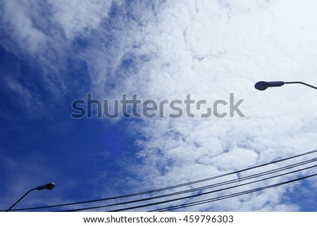 Blue Sky White Cloud with Electric Pole and Lamp Post Blur Background - stock photo