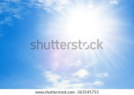 Blue sky with bright sun beams - stock photo