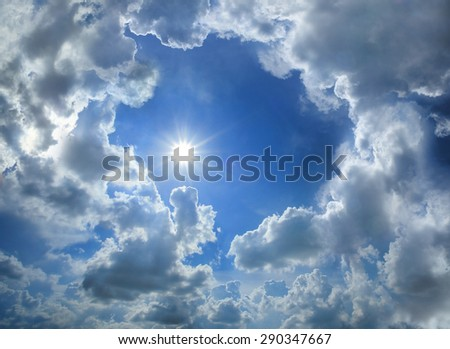 Blue sky with cloud and the sun. - stock photo