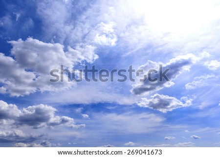 Blue sky with clouds and sun lights. - stock photo