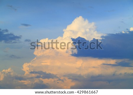 Blue sky with clouds and sunlight - stock photo