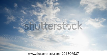 blue sky with clouds and sunlight, panorama - stock photo