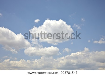 blue sky with clouds closeup - beautiful sparse clouds - stock photo