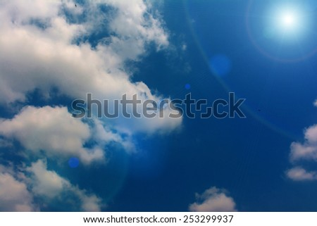 Blue sky with clouds in sunshine day. - stock photo