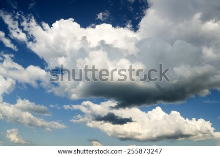 Blue sky with clouds. Nature composition - stock photo