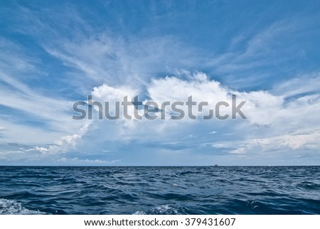 Blue sky with clouds over sea. Nature composition - stock photo