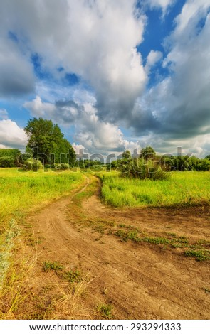 Blue sky with clouds over the hills (rural landscape). - stock photo