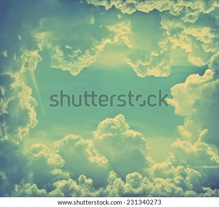 Blue sky with clouds. Retro stale. - stock photo