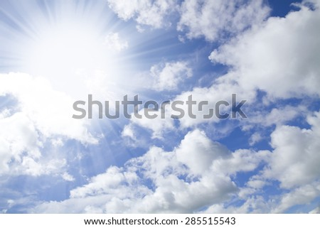 Blue sky with clouds with sun burst - stock photo