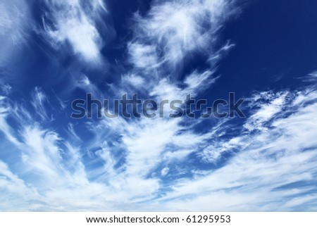 Blue sky with fleecy clouds, may be used as background - stock photo