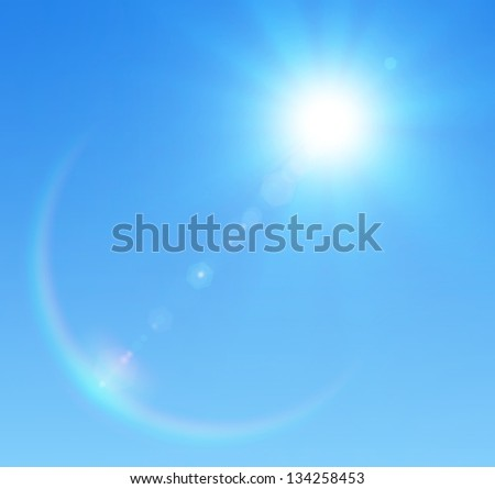 Blue sky with glaring sun - stock photo