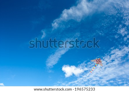 Blue sky with kite - stock photo