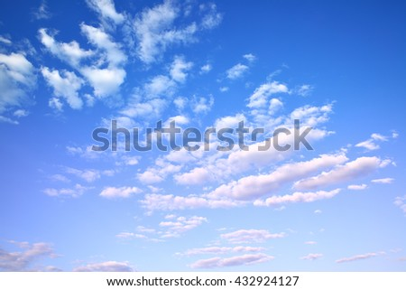 Blue sky with light cumulus clouds, may be used as background - stock photo