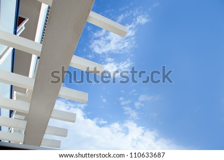 Blue sky with mediterranean white beams architecture detail - stock photo