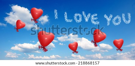 blue sky with red balloon hearts and I love you message - stock photo