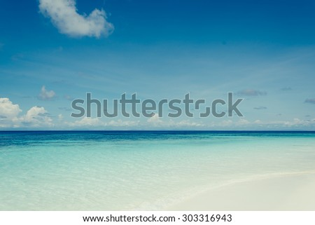 blue sky with sea and beach - stock photo