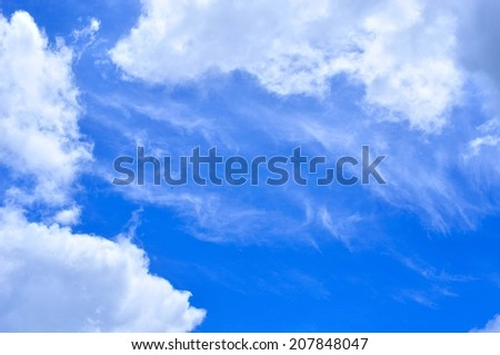 Blue sky with some white cirrus clouds. Natural background - stock photo