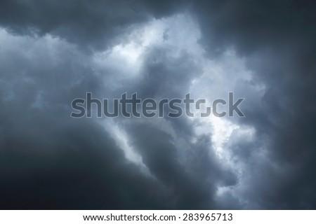 blue sky with storm cloud closeup - stock photo