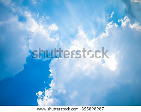 Blue sky with sun and beautiful clouds. - stock photo