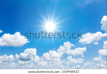 blue sky with sun and clouds - stock photo