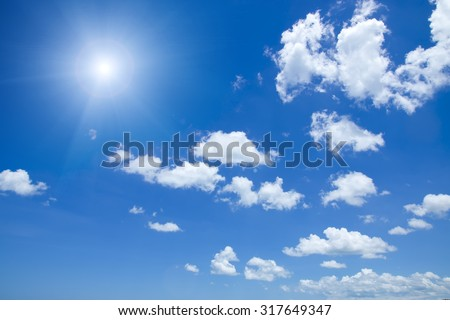 Blue sky with white cloud and sun. - stock photo