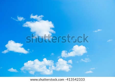 Blue sky with white clouds and sun shining out. - stock photo