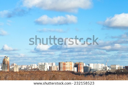 blue sky with white clouds over city in sunny autumn day - stock photo