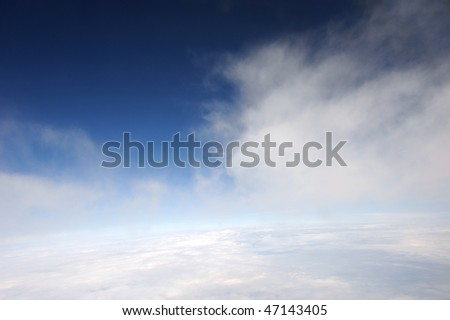 Blue sky with white clouds: space view of the Earth - stock photo